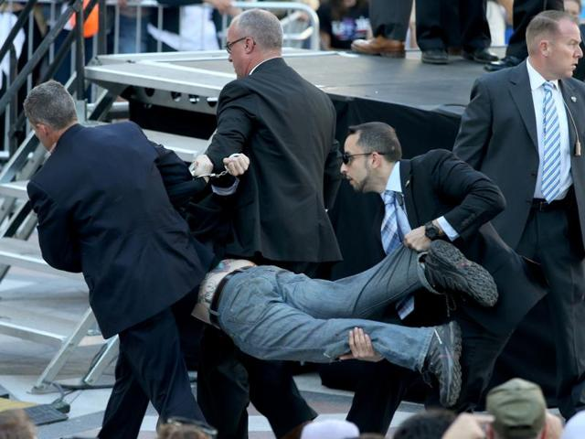 Secret Service agents remove a man from the crowd during a campaign rally for Democratic presidential hopeful, Senator Bernie Sanders, in Oakland, California, on Monday, May 30, 2016.