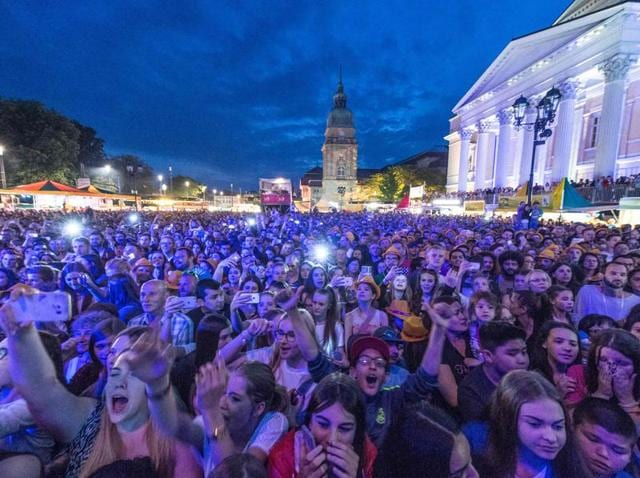 A photo taken on May 26 in Darmstadt, western Germany, shows people enjoying an open air concert during the Schlossgrabenfest music festival, where some women reported incidents of sexual assaults.