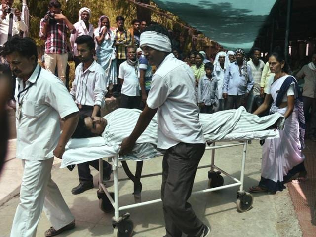 Medics carry a man injured in the Pulgaon arms depot fire to hospital in Wardha, some 100kms from Nagpur Tuesday.