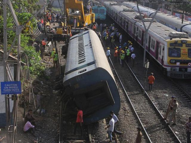 Women try to get inside a packed train at Andheri on Tuesday