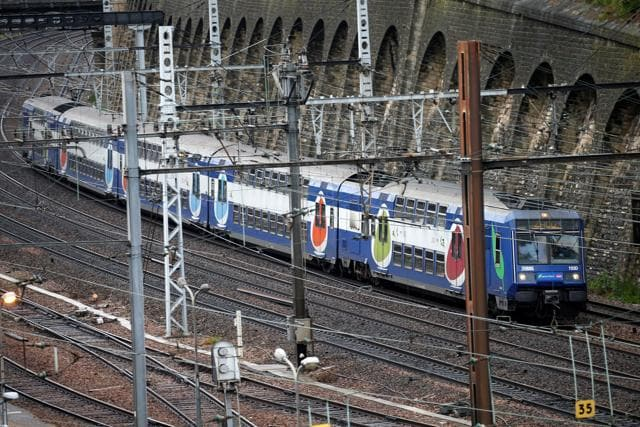 A Transilien, the suburban railway service of French state-owned railway company SNCF, speeds on the railtrack in Charenton-le-Pont near Paris as railway workers start a national railway strike on Tuesday evening.
