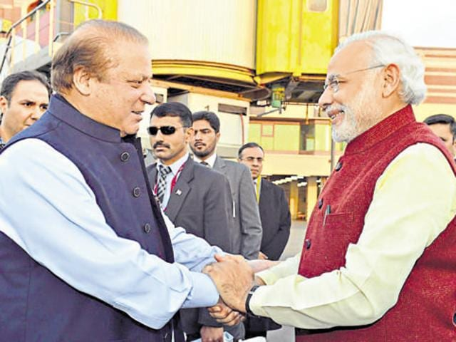 Prime Minister Narendra Modi shakes hands with his Pakistani counterpart Nawaz Sharif in Lahore.