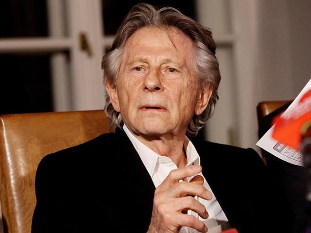 In this file photo taken in Krakow, Poland, Oct. 30, 2015, filmmaker Roman Polanski talks to reporters after a Polish judge ruled that the Polish law forbids his extradition to the US, where in 1977 he pleaded guilty to having had sex with a minor.