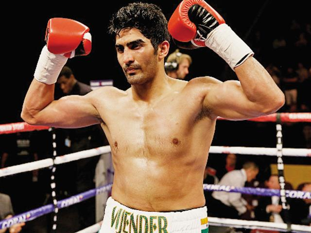 Vijender Singh of India celebrates after defeating Sonny Whiting of Great Britain.