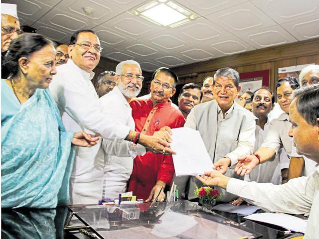 Pradeep Tamta (3rd from L) filing his nomination for Rajya Sabha at the assembly in Dehradun on Tuesday.