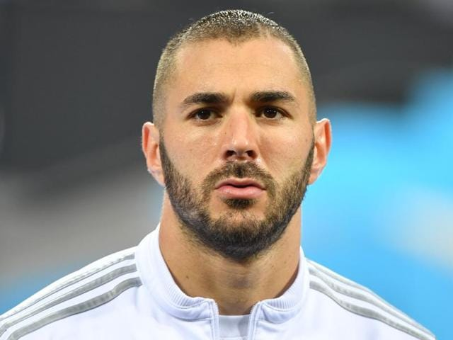 France's top scorer Karim Benzema accused coach Didier Deschamps of bowing to pressure from a