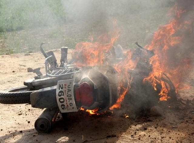 Vehicles were torched by angry mob after a clash at Landhaura in Roorkee on Wednesday.