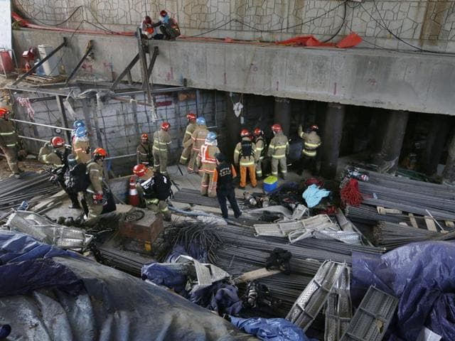 Rescue workers search for survivors after an explosion at a subway construction site in Namyangju, South Korea.
