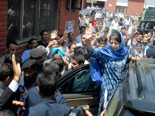 Chief minister of Jammu and Kashmir Mehbooba Mufti waves to crowd after filling her nomination papers for bypoll to Anantnag assembly segment.