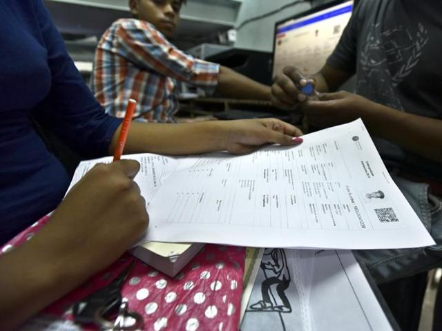 Students filling up Delhi University admission form on the second day of registration in New Delhi on Thursday.
