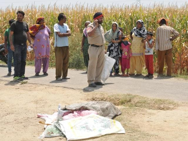Police inspecting the spot where the body of seven-year-old Neeraj was found at Nangal Salempur village on Wednesday.