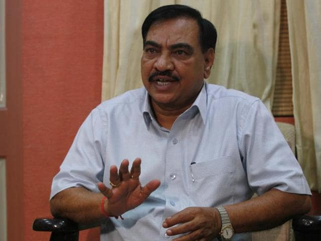 """Police inspector Hiraman Shirsath, attached with Shivaji Nagar police station, in a secretly filmed video, seen claiming that Khadse forced him to """"implicate"""" Gavande in January 2015 by asking the official to file a complaint related to """"land grabbing""""."""