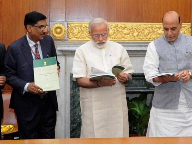 Prime Minister Narendra Modi with home minster Rajnath Singh and MoS Kiren Rijiju at the release of the National Disaster Management Plan (NDMP).