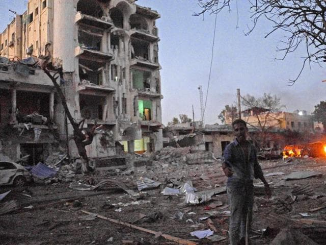 A man stands next to the Ambassador Hotel, after Somalia's al Qaeda-linked Shabaab on June 1, 2016, launched a deadly attack on a top Mogadishu hotel.