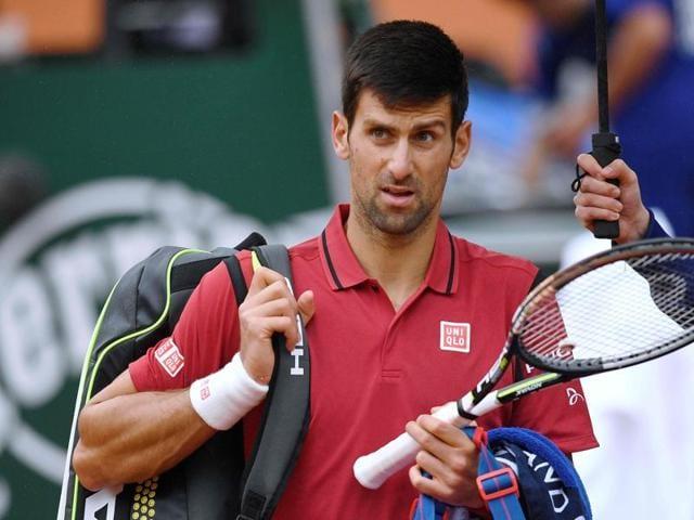 Djokovic celebrates his win with a ball boy.