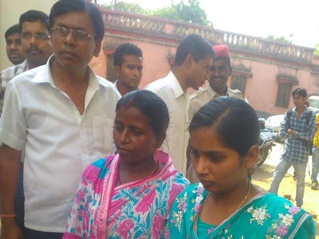 Third topper of Bihar board Arts exam Khushbu Kumari (in green dress) reaches the re-examination centre.