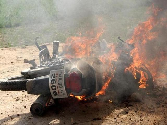 Vehicles were torched by angry mob after a clash at Landhaura on Wednesday.