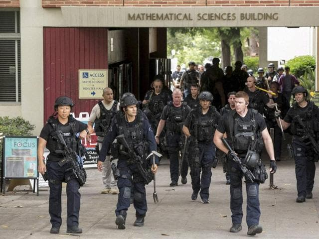 Los Angeles Police officers walk by the Mathematical Sciences Building on the UCLA campus after a fatal shooting incident.(AP Photo)