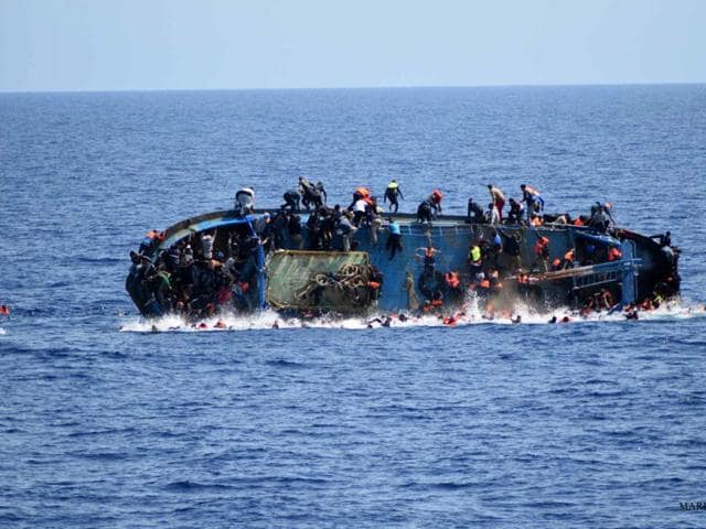 More than 300 migrants were rescued and three bodies recovered off the Greek island of Crete after a boat carrying at least 700 people capsized.