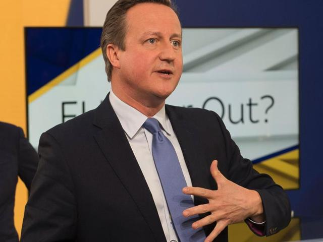 British Prime Minister David Cameron speaking with members of the audience during a televised event in London on Thursday. Cameron urged Britons not to