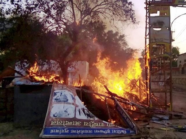 A house set on fire after clashes between the police and the encroachers who were being evicted from Jawaharbagh in Mathura on Thursday.