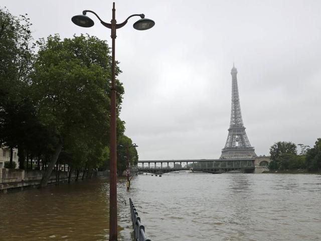 View of the flooded river-side of the River Seine near the Eiffel tower in Paris on Friday, after days of almost non-stop rain caused flooding in the country.