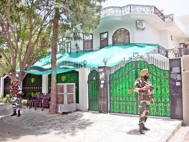 Border Security Force personnel deployed outside Haryana finance minister Captain Abhimanyu's residence, which was burnt during the Jat stir in February, at Rohtak on Thursday.