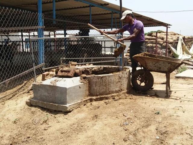 A labourer at work at a biogas plant at Loharan village in Jalandhar.
