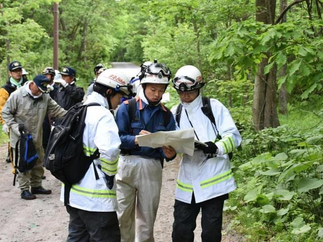 A seven-year-old boy missing after being abandoned in a bear-inhabited forest in northern Japan  nearly a week ago, was found alive on Friday and reunited with his parents, officials said.