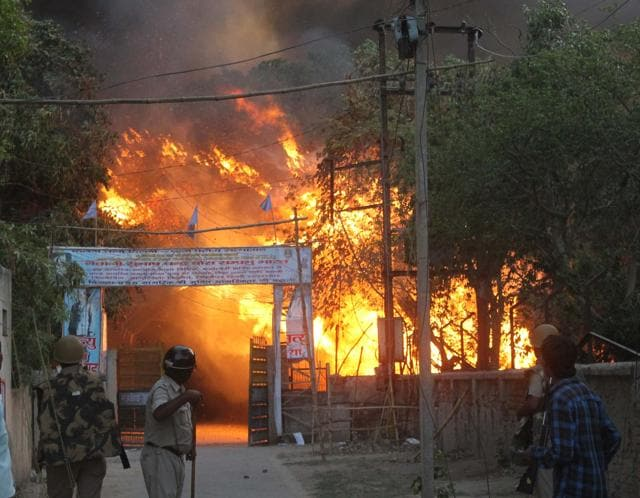 A fire break out after clashes between police and encroachers who were being evicted from Jawaharbagh in Mathura on June 2.