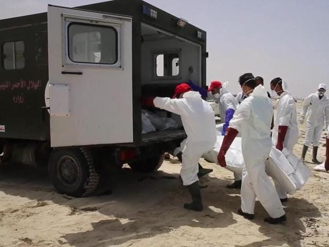 Emergency services remove the body of a victim as more than 100 bodies are pulled from the sea near the western city of Zwara in Libya on Friday after a smuggling boat carrying mainly African migrants sank into the Mediterranean.