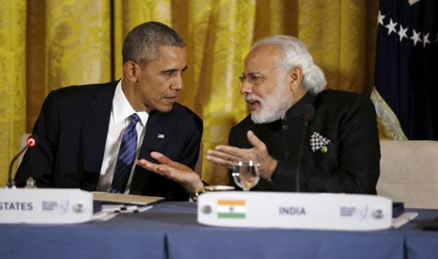 U.S. President Barack Obama talks with Indian Prime Minister Narendra Modi during a working dinner at the White House in March 2016.