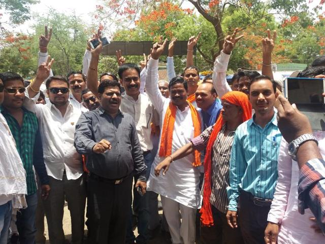 BJP candidate Mangal Singh Dhruve (in orange scarf) celebrating Ghodadongri assembly bypoll victory with his supporters on Thursday.
