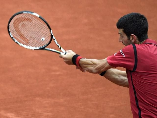 Serbia's Novak Djokovic reacts during his men's quarter-final match against Czech Republic's Tomas Berdych during their men's quarterfinal match at the Roland Garros 2016 French Open in Paris.