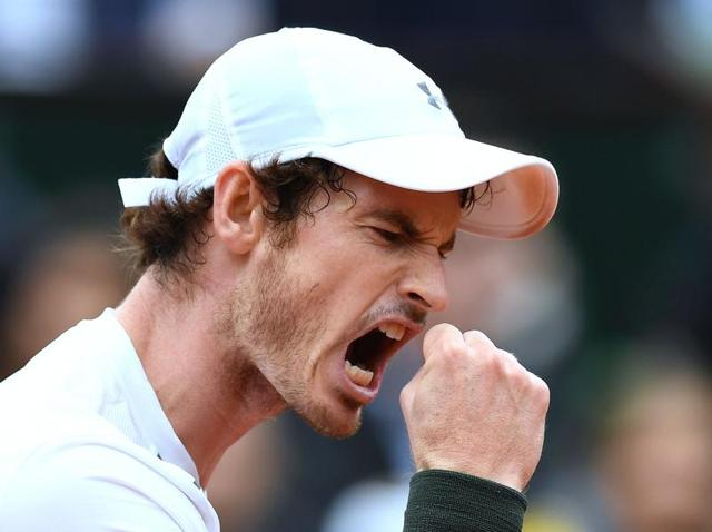 Great Britain's Andy Murray reacts after winning a point during his men's quarterfinal match against France's Richard Gasquet at the Roland Garros 2016 French Open in Paris.
