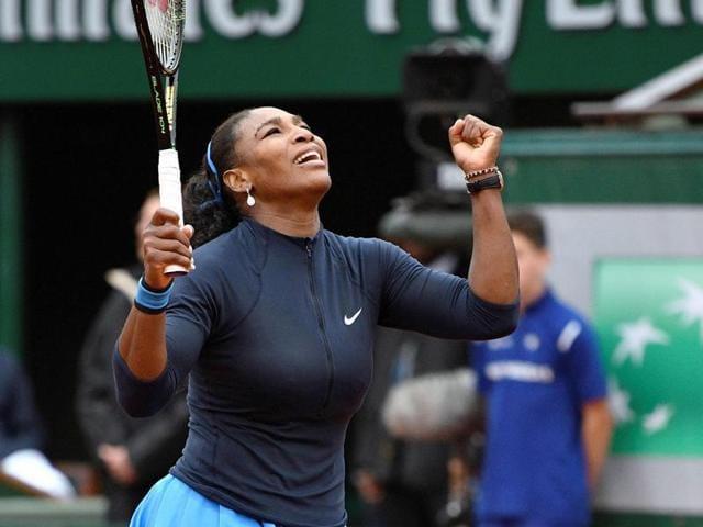 US player Serena Williams celebrates after winning her women's quarterfinal match against Kazakhstan's Yulia Putintseva at the Roland Garros 2016 French Open in Paris.