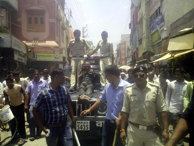 Police in Mahidpur town of Ujjain district beat up and paraded an accused on Thursday.