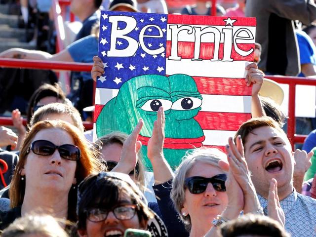People cheer at a campaign rally for US Democratic presidential candidate Bernie Sanders in Irvine, California.