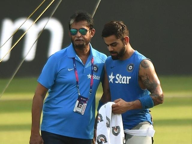 India cricket team's chief selector Sandeep Patil (left) speaks with Virat Kohli during a training session at the Wankhede stadium in Mumbai.