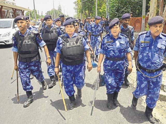 Paramilitary troops and Punjab Police personnel take part in a flag march in Amritsar.