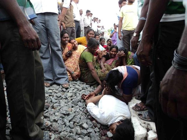 Relatives of 19-year-old Dalit student E Ilavarasan mourn by the railway tracks where he was found dead in 2013, after he eloped with a woman from another caste.