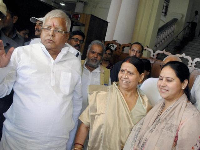 RJD candidate Misa Bharti with her father and party chief Lalu Prasad and mother Rabri Devi after filing nomination papers for Rajya Sabha elections, at Bihar Assembly in Patna.