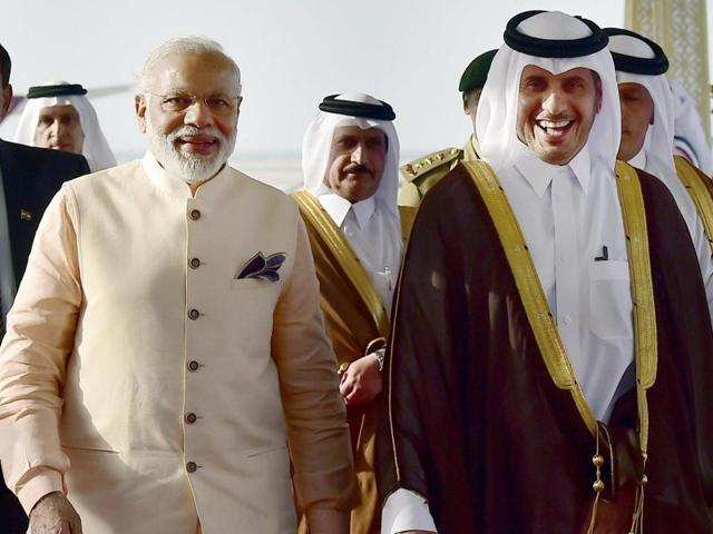 Prime Minister Narendra Modi with his Qatar counterpart Emir of Qatar Abdullah bin Nasser bin Khalifa Al Thani during arrival at Doha airport on June 4, 2016.