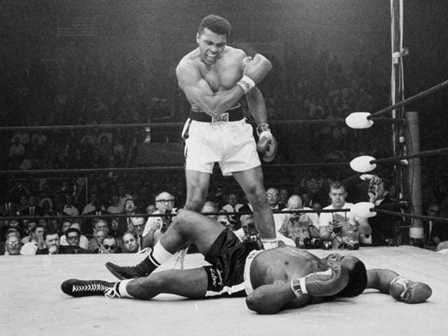 In this May 25, 1965, file photo, heavyweight champion Muhammad Ali, stands over challenger Sonny Liston, shouting and gesturing shortly after dropping Liston with a short hard right to the jaw, in Lewiston, Maine.