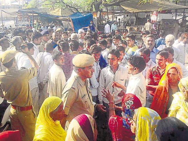 People protest in front of the Government Janana Hospital in Alwar on Friday.