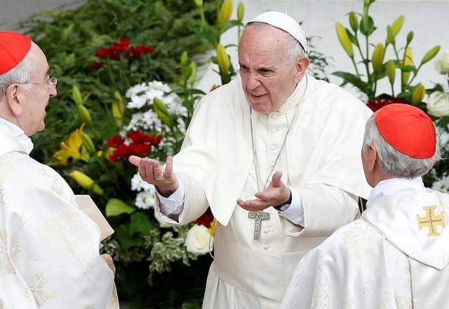 Pope Francis gestures as he is greeted by Cardinals at the end of a mass for the Jubilee of Priests at St. Peter's Square at the Vatican on Friday.