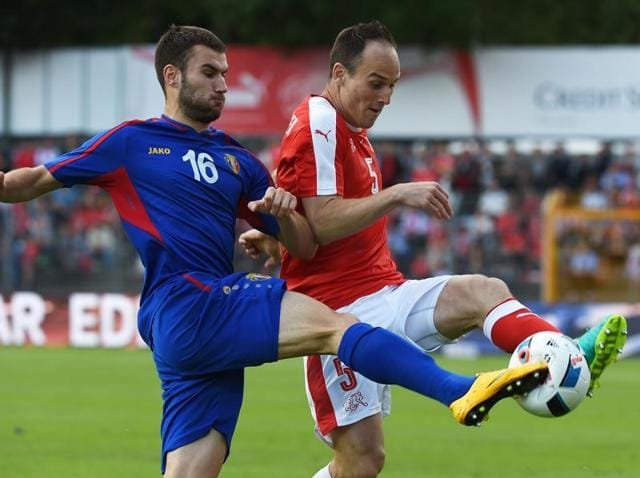 Switzerland's Xherdan Shaqiri in action against Moldova's Adrian Cascaval.