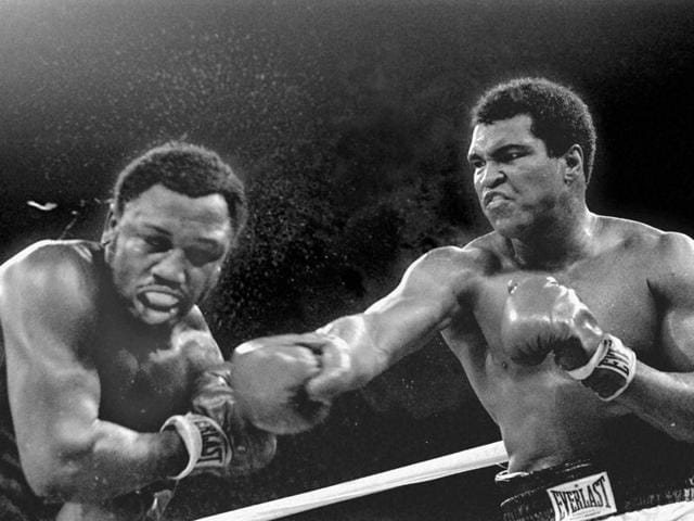 In this Feb. 25, 1964, file photo, Muhammad Ali, or Cassius Clay at the time, strikes a familiar pose as he shouts