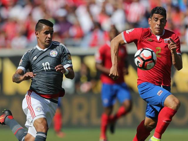 Dario Lezcano (#19) of Paraguay and Yeltsin Tejeda (#17) of Costa Rica vie for possession during the Copa America Centenario Group A match between Costa Rica and Paraguay at Camping World Stadium on June 4, 2016 in Orlando, Florida.