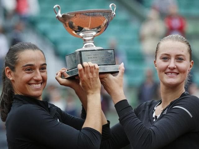 Caroline Garcia, left, and Kristina Mladenovic of France celebrate with the trophy after winning the women's doubles final of the French Open.